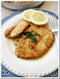 Chicken Francese - 4 skinless, boneless, chicken breasts (about 1-1/2 pounds), flour, for dredging salt and freshly ground black pepper 4 large eggs 3 tablespoons water 1/4 cup olive oil 1/2 lemon, w/ rind, cut in thin rounds 1/2 cup dry white wine 1 cup chicken broth 1/2 lemon, juiced (although I juice just about a whole lemon) 2 tablespoons butter 1/4 cup chopped parsley