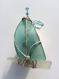 RARE TEAL SEA-GLASS SAILBOAT PENDANT  - Linda Rae Dixon creates art with gems of sea glass that have been perfected by nature and found by her on local beaches.  I search, find and repurpose treasures from the past turning them into beautiful creations of the present. I can even use your SPECIAL FIND and create a beautiful design just for you. Don't just covet it, wear it! Lindaraedixon@gmail.com