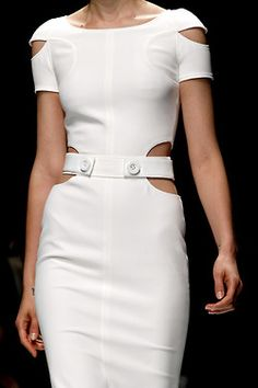 Versace. I wish that there were sheer white toning fabric inside the cut at the waist. Still sexy, but modest.