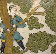 A SAFAVID CUERDA SECA POTTERY TILE   ISFAHAN, 17TH CENTURY   Of square form, the white ground decorated in yellow, turquoise, cobalt, brown and green with dark outline, a young man with his head turned away climbs a leafy tree, heavy gold fram