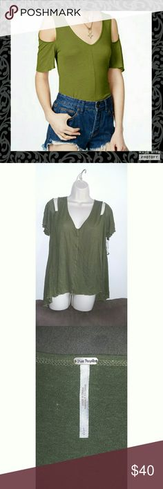 Free People Dark Green Cold Shoulder Top V neck pullover style tee shirt top. Cold Shoulder. Dark green in color. Rayon blend material. Longer in the back than the front. Super comfy soft material. With that extra drama look you were going for. New with tags Free People Tops