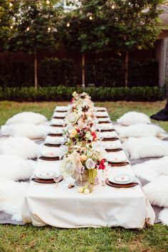 Houston calligrapher Meg Grant takes us inside her bohemian backyard dinner party, complete with a low dining table and flowers for days.