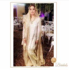Aminah Tariq looking beautiful on her Nikkah in an ivory and gold #FarahTalibAziz kalidaar #FarahTalibAzizBrides