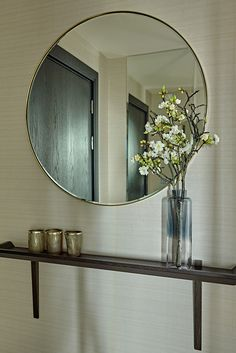 Round Hallway Mirror with wall-mounted shelf for keys, mail etc in the entrance of our Battersea Penthouse project. Hallway Mirror, Art Above Bed, Bed In Living Room, Boutique Interior Design, Wall Mounted Shelves, Shelf, Kitchen Wall Colors, Wall Paper Phone, Rustic Walls
