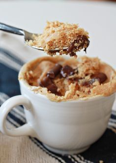 """Easy Vegan Peanut Butter Mug Cake recipe - Just 3 minutes from sweet tooth attack to bliss! Utterly delicious whether you're vegan or not. (I affectionately call this """"tea cup cake"""" because it's a petite version that makes just enough to satisfy my sweet tooth without feeling like I went overboard.)"""