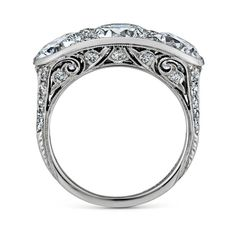 Tiffany & Co. Art Deco Three Stone Diamond Platinum Engagement Ring | From a unique collection of vintage engagement rings at https://www.1stdibs.com/jewelry/rings/engagement-rings/