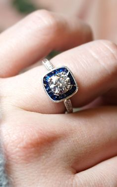 Blue Sapphire Vintage-Inspired Art Deco Halo Diamond Engagement Ring | Joseph Jewelry | Bellevue | Seattle | Online | Designers of Fine Custom Jewelry