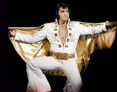 White Adonis suit. This was most famously worn by Elvis at his Legendary Madison Square Garden Concerts in June 1972.   Worn with the Gold belt and Gold lined cape it was quite spectacular.