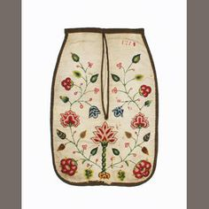 An embroidered linen pocket, dated 1718  Of cream linen, bound with brown cotton, embroidered with polychrome floral wool crewelwork,  32.5 x 22cm.