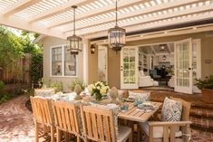 GAH! I want it all. Sunny outdoor entertaining spot with teak table, pergola, and pendant lights! <3