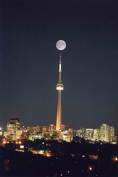 We ate dinner in the CN Tower at the revolving restaurant. Not a hue fan of Toronto in general.Full moon over CN Tower, Toronto, Canada Torre Cn, Places Around The World, The Places Youll Go, Places To Visit, Around The Worlds, Ontario, Beautiful Moon, Beautiful World, Shoot The Moon