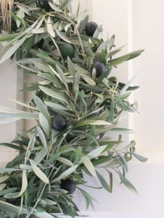 Corona de ramas de olivo