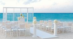 Such an elegant beach wedding set up! Leave it to the Colin Cowie Collection.