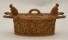 Bentwood box with low relief acanthus carving. Box and springs on side are carved from a single piece of wood. Lid and handle are also carved from a single piece of wood. Base has been glued on. Norwegian, ca. 1900