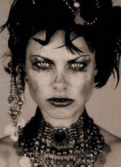 """I just have to take a minute here to say, """"How fantastic is this lady?!"""" Her intensity is *gorgeous*. (I wouldn't go for this makeup look, but as an art piece, this is spectacular. There's a sense of story, character, beauty, determination, fierceness, toughness, elegance, and attitude. I am, quite frankly, in love.)"""