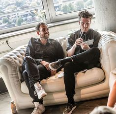 1/2 of Bastille on a couch