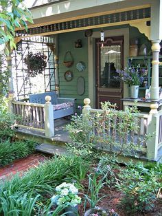 Cottage style porch with rocker and wall decor...
