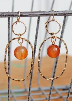 """The name couldn't be more fitting. Add a sweet touch of amber hue to your everyday gold earring. Measures 2.5"""" in length including hook. $25.00"""