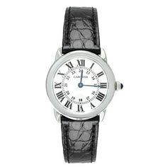 Cartier Women's W6700155 Ronde Solo Black Leather Watch Cartier. $2180.00. Scratch-resistant-sapphire crystal; Case diameter: 29 mm. Roman numeral silvered opaline dial; Sword-shaped blued steel hands; Stainless steel circular crown set with synthetic cabochon spinel crystal. Water-resistant to 99 feet (30 M). Solid polished stainless steel case; Crocodile patterned black genuine leather strap. Swiss Made watch with Cartier Calibre 690 Swiss-quartz movement