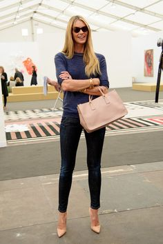 I love the way Elle Macpherson lightened up a dark denim look with pointy nude pumps and a matching nude statement handbag!