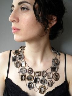 Ashley Gilreath created this beautiful and wearable piece of art -I Am Who They Were. She cast the frames individually by hand, and used vintage family portraits on transparent glass to fill them!