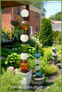 In July of 2012 I built these two glass totems .       They became pretty popular on Pinterest  and Hometalk  and have generated a LOT of qu...