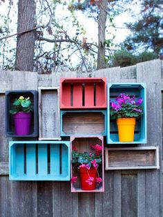 Add open storage to your yard or garden with wooden crates grouped and installed along a fence or exterior wall.