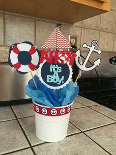 Handmade cutout $10 per set 1 Ahoy Its a Boy! 1 lifesaver 1 Sailboat 1 Anchor 1 Ship Wheel  For more than one order, please message me and we can work it out. Cutouts are made to order and can be customized.