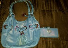 Authentic Michael Kors Large Blue Grommet Handbag w/wallet included!!!