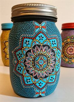 Hand Painted Glass Jar   I painted this jar one dot at a time... I first painted on the mandala design and then added dots in an assortment of