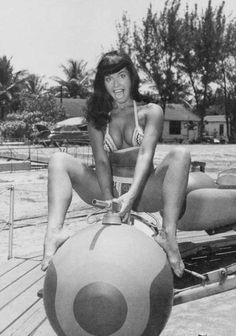 When Bunny Yeager took Bettie to a theme park, early in the morning to take these photos, they were both worried that the skimpy outfits, made by Bettie, would get them arrested if caught.