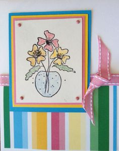liked this card, so I made 2 - stamp the flowers on white, add backing using the colors from the striped paper, then add brads and ribbon...