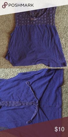 NAVY BLUE TANK Has a unique, see-through neck area. In great condition. Back of shirt opens about 5-6 inches up. Abercrombie & Fitch Tops Tank Tops