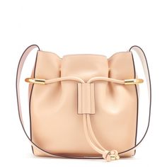 Chloé - Emma leather shoulder bag - The bucket bag has been topping the It bag charts for the last few seasons. Chloé's 'Emma' resonates with elegance and soft femininity, crafted from soft leather that's gathered by snap-button fastenings and a dainty drawstring accented with luxe gold-tone hardware. Throw in all your daily essentials and take on the day in style. seen @ www.mytheresa.com