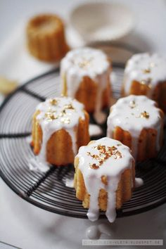 Small individually iced cakes.