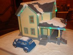 A gingerbread replica of the Christmas Story house, including a car made out of rice krispie treats.  By the fabulously talented LuluSweetArt on cakecentral.