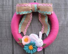 Easter Pom Pom Wreath with Bunnies and Chicks Bright Easter Easter Crafts For Kids, Fall Crafts, Easter Wreaths, Spring Wreaths, Craft Stick Crafts, Diy Crafts, Pumpkin Ornament, Pom Pom Wreath, Halloween Ornaments