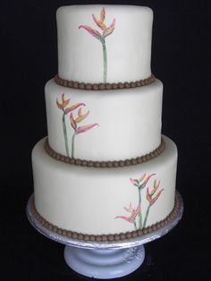 Handpainted birds of paradise wedding cake