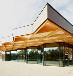 Criss-crossing timber canopy extends over Ackermann + Ruff's glass-fronted festival hall (via Bloglovin.com )