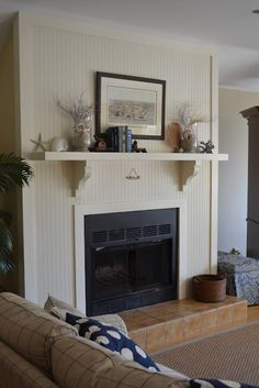 love the beadboard around the fireplace. especially if we do beadboard on kitchen island! Cream Fireplace, Farmhouse Fireplace, Fireplace Wall, Fireplace Surrounds, Fireplace Design, Fireplace Ideas, Fireplace Update, Fireplace Mantles, Mantels