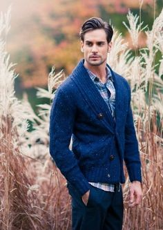 Go for a navy shawl cardigan and navy chinos to create a smart casual look.  Shop this look for $75:  http://lookastic.com/men/looks/blue-plaid-longsleeve-shirt-and-navy-shawl-cardigan-and-navy-chinos/3839  — Blue Plaid Longsleeve Shirt  — Navy Shawl Cardigan  — Navy Chinos