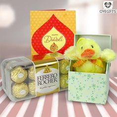 Surprise Toy Box & Chocolates For Your Loves One - OyeGifts   Surprise your kid on the auspicious occasion of Diwali in a special way with this gift hamper. This lovely hamper  containing 200 gms Ferrero Rocher chocolate box, a pop out ducky toy box and a Diwali greeting card is sure to bring a smile on her or his face.