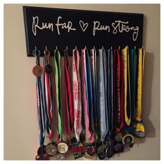 Run Far Run Strong Medal Hanger by Strut Your Stuff Sign Co.