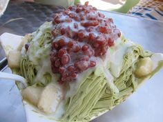 Green Tea traditional Taiwanese shaved ice infused with condensed milk with mochi and red bean toppings.  May I try this one day.