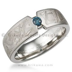 Mokume Compass Diamond Wedding Band   this masculine wedding band is inlaid with mokume gane and displays a small accent diamond. The shape of where the band meets the stone resembles a drafting compass. Priced with a 0.11 ct white ideal cut diamond.