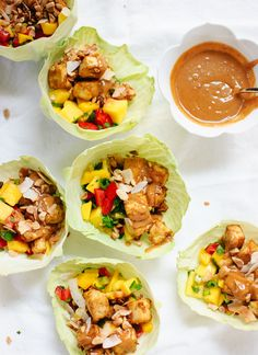 Thai Mango Cabbage Wraps with Crispy Tofu and Peanut Sauce Mango salsa cabbage wraps with crispy baked tofu and an irresistible peanut sauce. These salad wraps are light and delicious! Recipe is gluten free & vegan. Thai Mango Salad, Mango Salsa, Vegetarian Recipes, Cooking Recipes, Healthy Recipes, Cooking Food, Vegan Vegetarian, Easy Recipes, Skinny Recipes