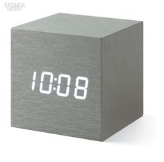 30 Office Products that Will Bring Comfort and Style to the Work Day | Alume Cube clock in wood and plastic with aluminum-effect veneer and snap-operated on/off switch by MoMA Design Store. #interiordesignmagazine #interiordesign #design #products #accessories