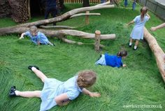 Rolling down a grass mound at St Andrews Primary, Hitchin.