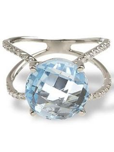 """Some topaz crystals can reach boulder size. This one comes close and we like it. Blue topaz and diamond """"Sky"""" ring, $925, greenwichjewelers.com"""