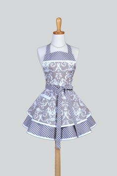 Our Ruffled Retro full woman's apron is a fun and flirty kitchen cooking apron in a vintage style full skirt. Made in an elegant grey and white damask with polka dot trims and underskirt, this apron i